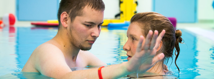 A National Star student in hydrotherapy session with physiotherapist.