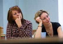 Two teachers sat together listen to the training.