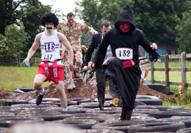 Thriller run participants run through tyres