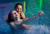 A National Star student in hydrotherapy pool with physiotherapist during a therapy session.