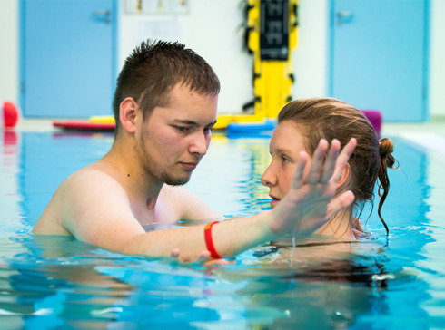 A National Star student in hydrotherapy session with physiotherapist