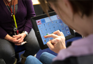Speech and Language therapist works with a National Star College student on using their communication device